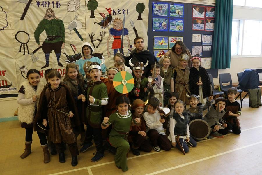 school children enjoying visit from JORVIK Vikings