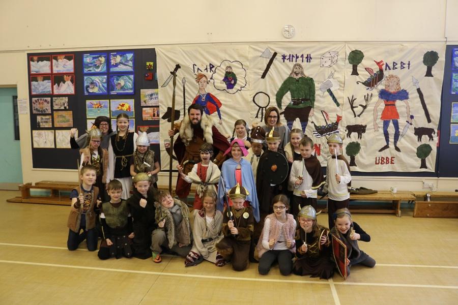 School children enjoying visit from JORVIK Viking
